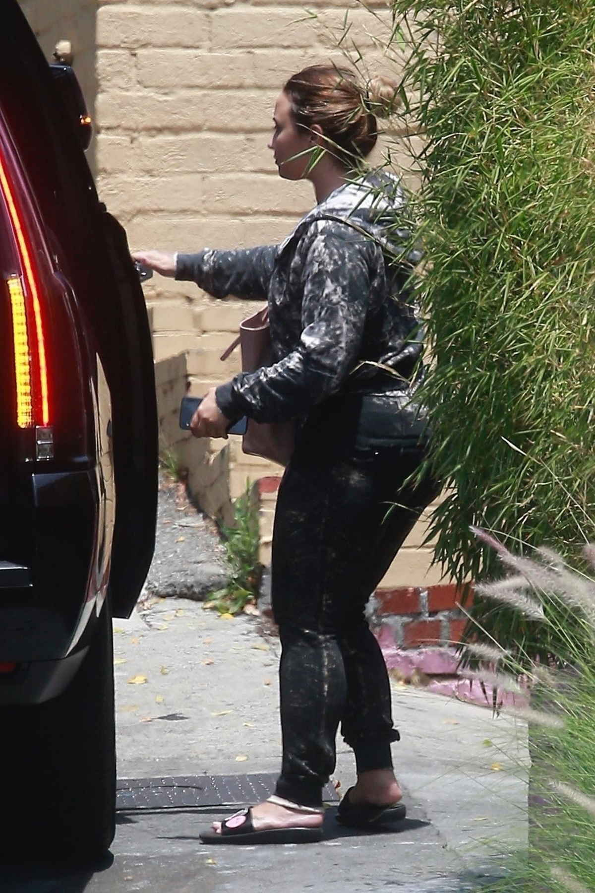 Hops_into_her_ride_after_leaving_the_gym_in_West_Hollywood2C_CA_-_July_1600003.jpg