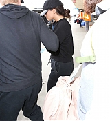 Arriving_at_LAX_Airport_With_Black_Outfit_-_July_24-06.jpg